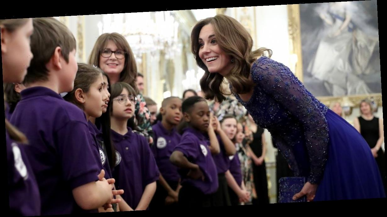 Kate Middleton dazzles in blue to host glitzy palace bash for children's charity