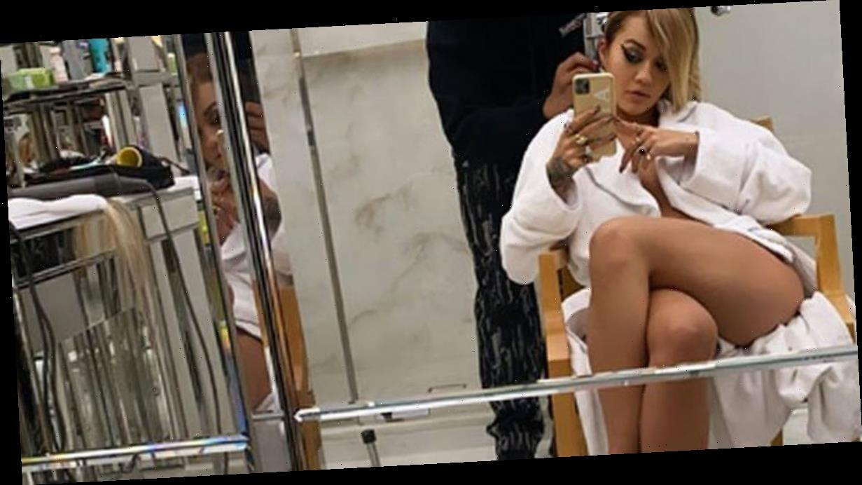 Rita Ora strips to her knickers to flaunt killer pins in racy backstage snap