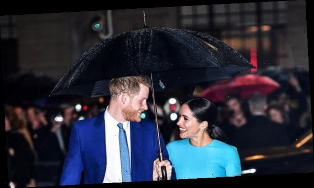 Meghan Markle & Prince Harry Cozy Up Under An Umbrella In Matching Outfits In London — See Pics
