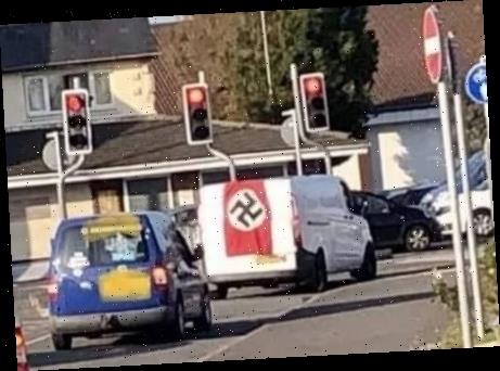 White van driver hunted by cops after draping huge swastika flag over back doors as it drove through busy roads