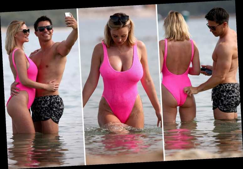 Rhian Sugden's husband Oliver Mellor grabs her bum as they pose for cute photos in the sea in Turkey
