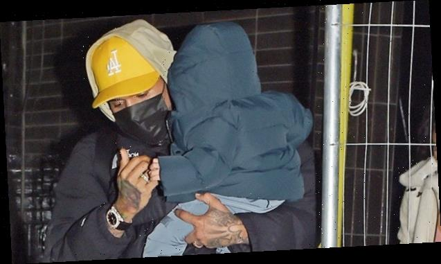 Chris Brown Cradles Son Aeko, 10 Mos., While Enjoying A Night Out In London With Ammika Harris