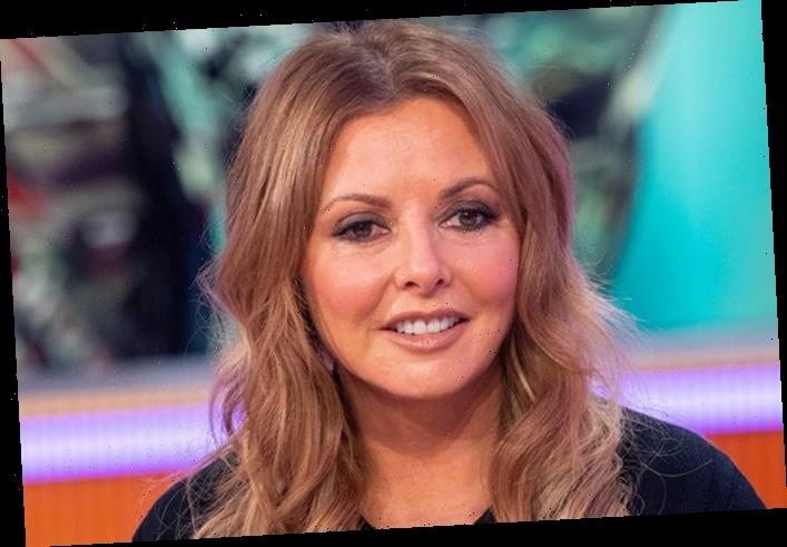 Carol Vorderman, 59, shows off PINK hair and pokes her tongue out in a sultry snap