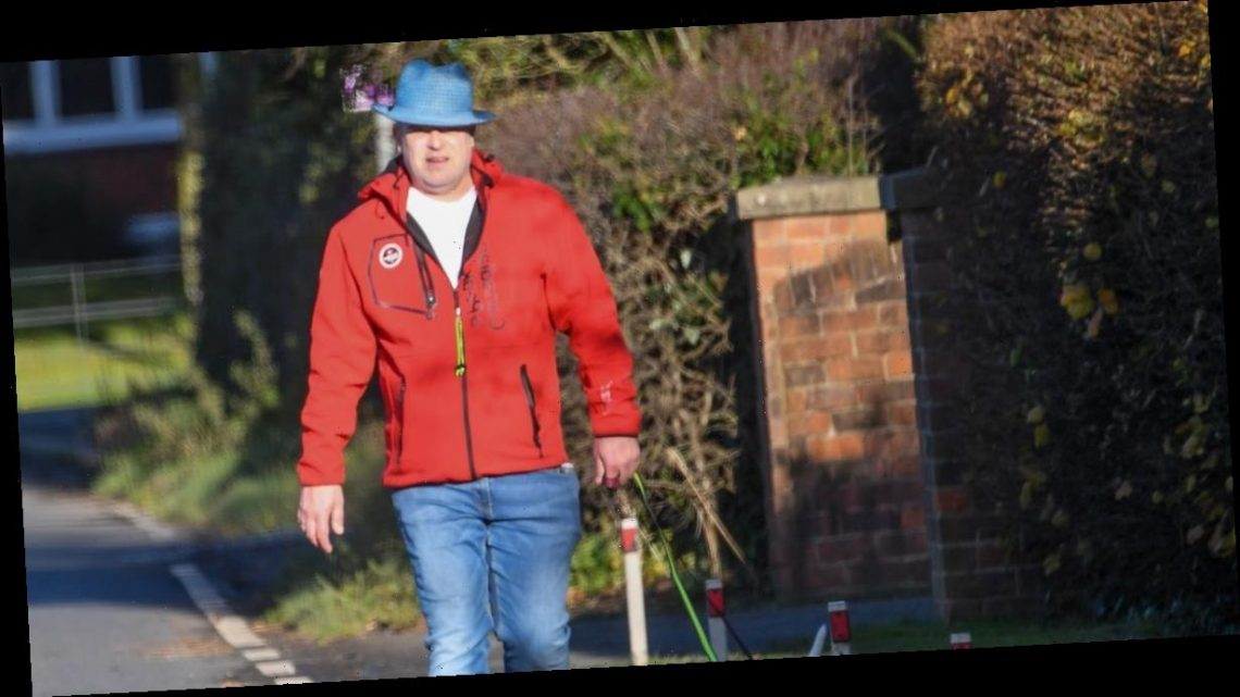 Coronation Street's Simon Gregson steps out in wellies as he walks dogs with wife Emma and son Henry