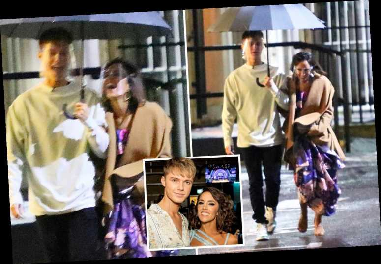 Strictly's HRVY cuddles up to partner Janette Manrara as they head into the studios ahead of live show
