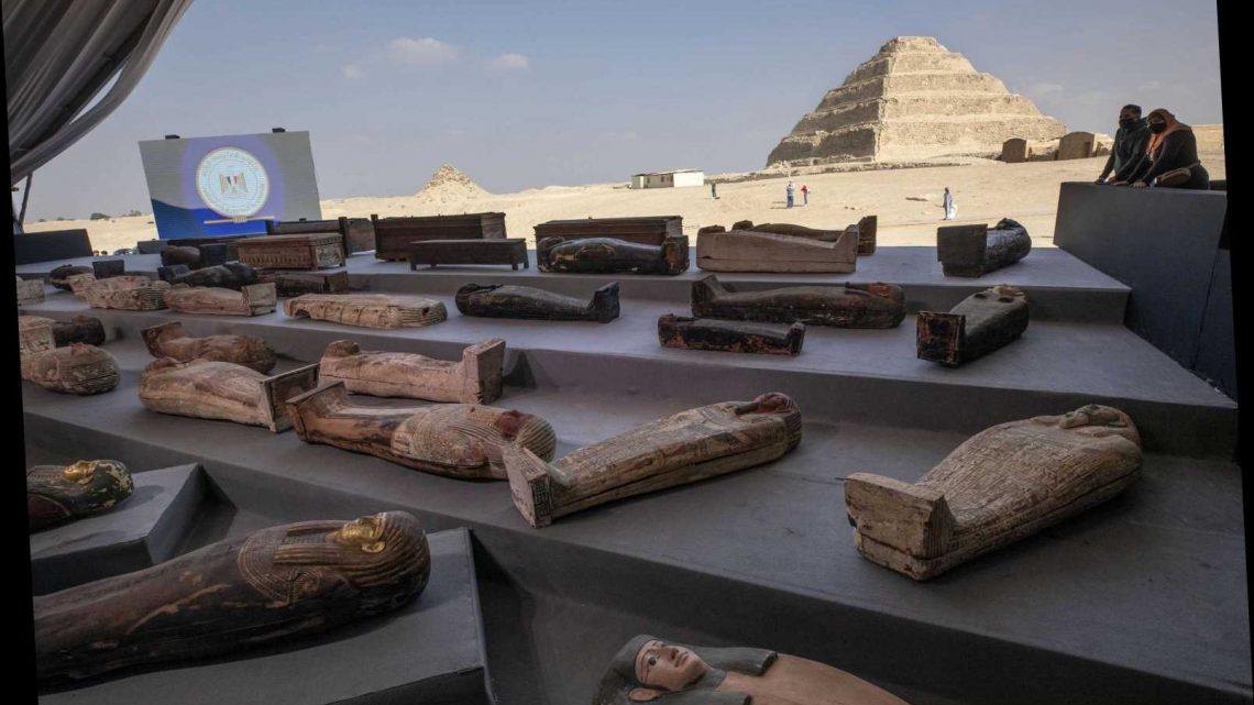 Egypt unveils ancient coffins, statues found in Saqqara
