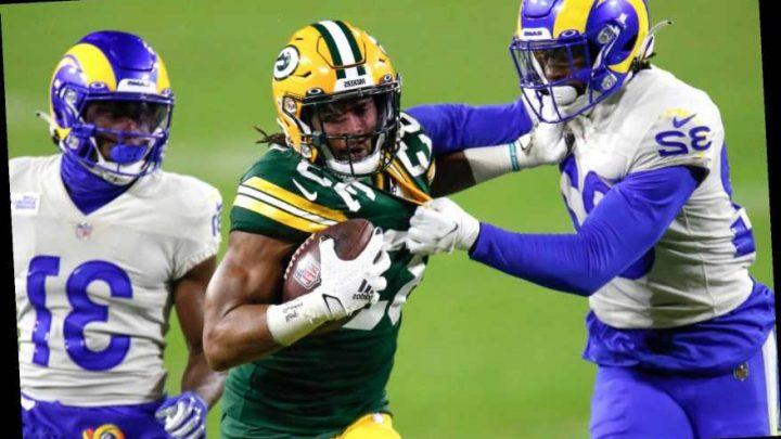 Packers overwhelm Rams with punishing ground game