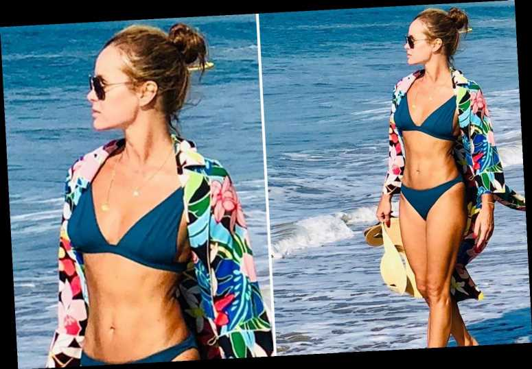 Amanda Holden looks incredible in throwback bikini pic as she slams influencers for going on holiday during the pandemic