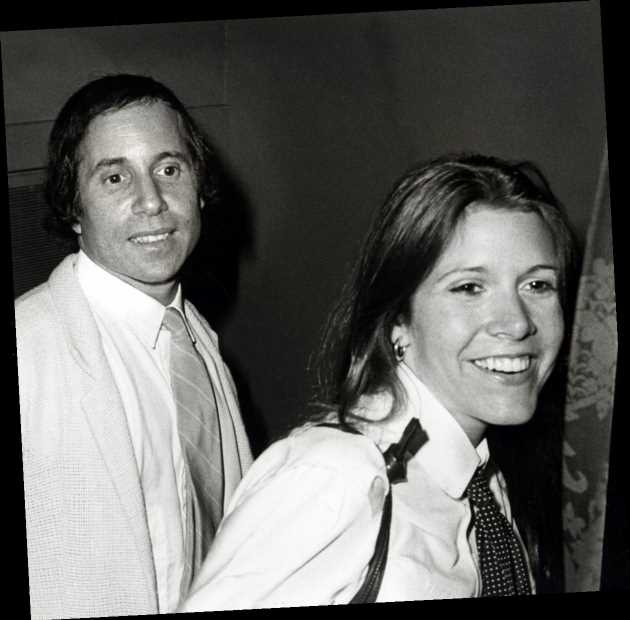Paul Simon Loved Carrie Fisher With a 'Desperation That Could Frighten Him,' According To Biographer