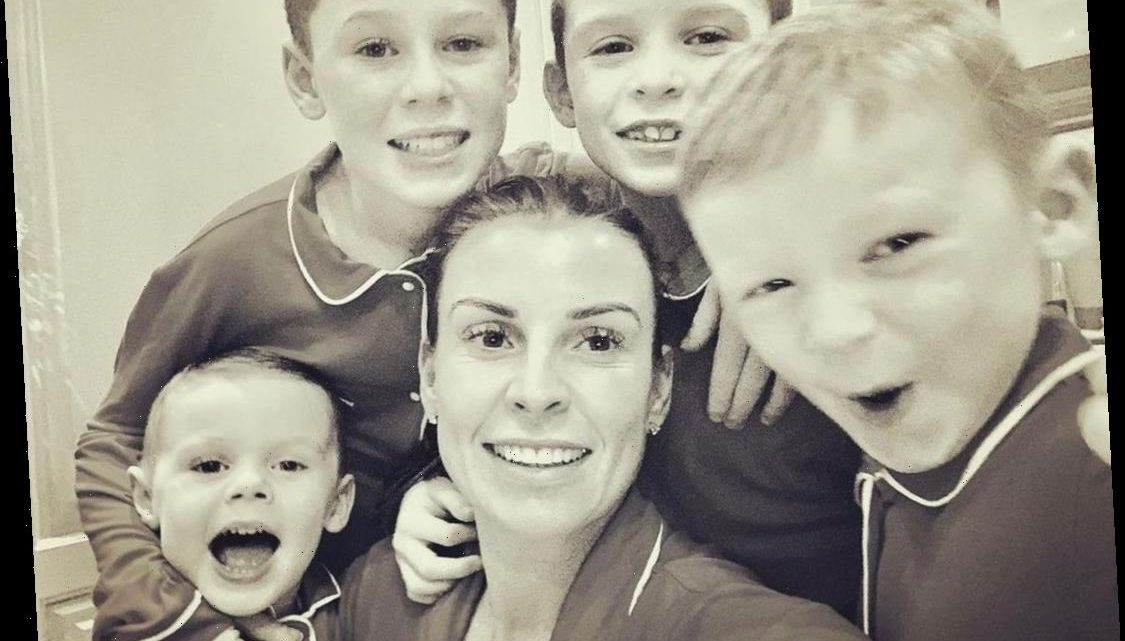 Coleen Rooney beams as she poses alongside sons Kai, Klay, Kit and Cass in matching pyjamas for New Year snap