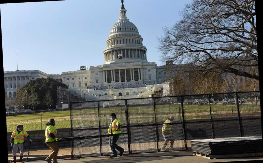 Workers install 7-foot fence around Capitol after siege
