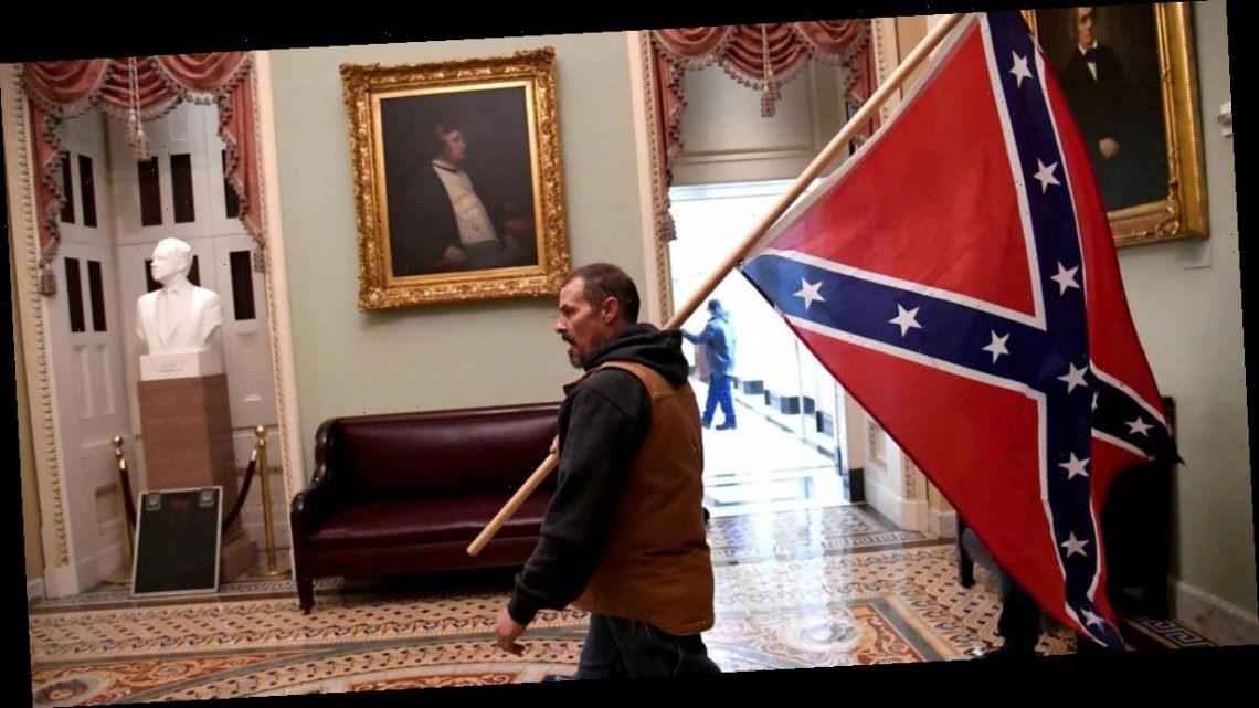 Man seen holding Confederate flag inside U.S. Capitol during riot arrested
