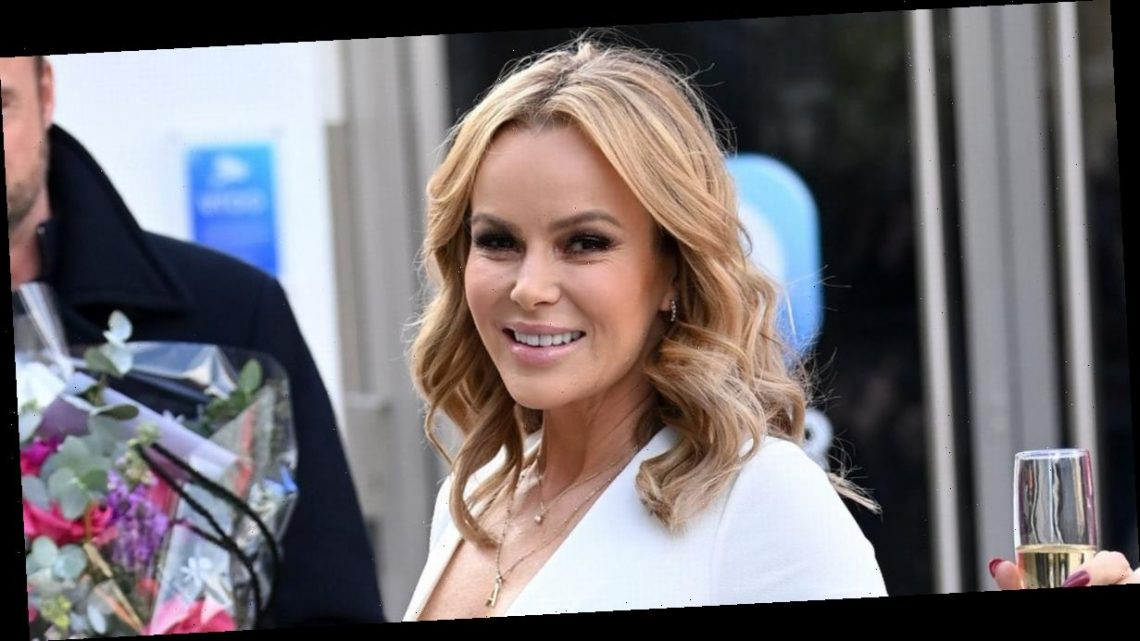Amanda Holden flaunts cleavage in plunging catsuit as she marks 50th birthday