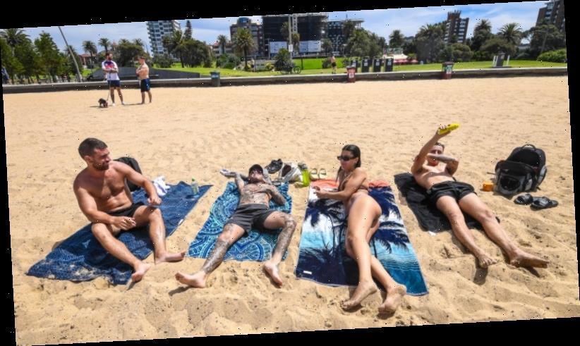 'Stuff it, it's hot': Hundreds ignore lockdown rules at St Kilda beach