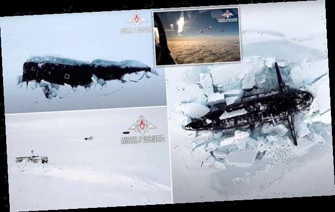 Putin hails Russian Navy as three  submarines smash through Arctic ice