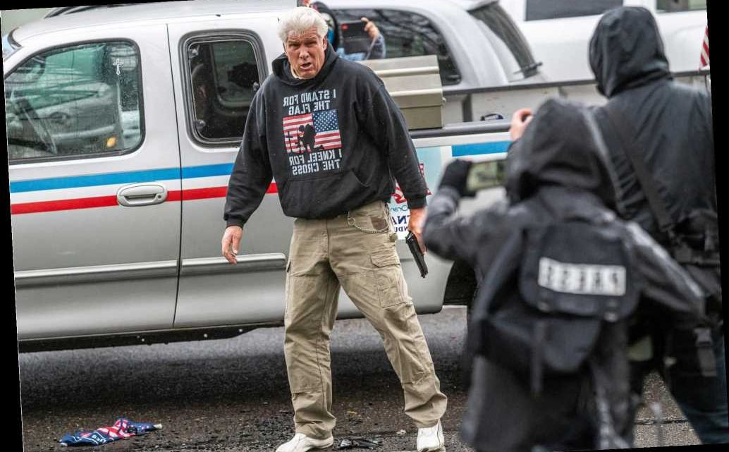 No charges for man who drew gun at dueling Oregon protests; four others arrested