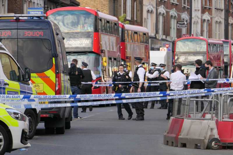 Man, 40, dies from stab wounds on London high street as cops launch murder probe