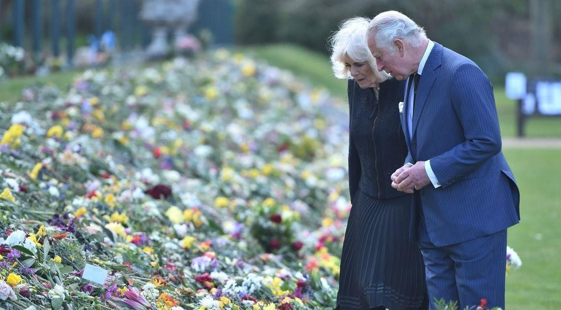 Prince Charles and Camilla make emotional visit to look at flowers and tributes left for Prince Philip