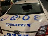 Vandals smash NYPD cop car window while officers respond to 911 call