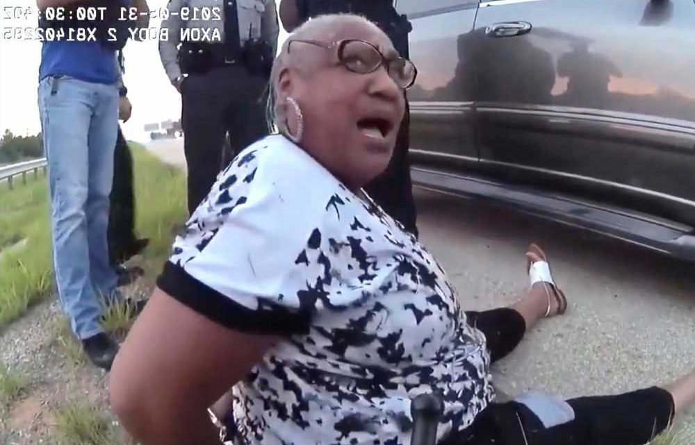 Video shows black librarian pulled from car by hair during traffic stop