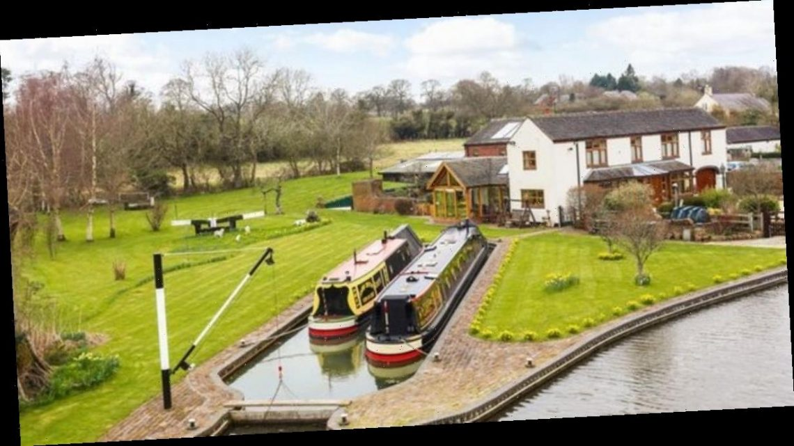 Stunning four bed dockland home with private mooring and courtyard for sale