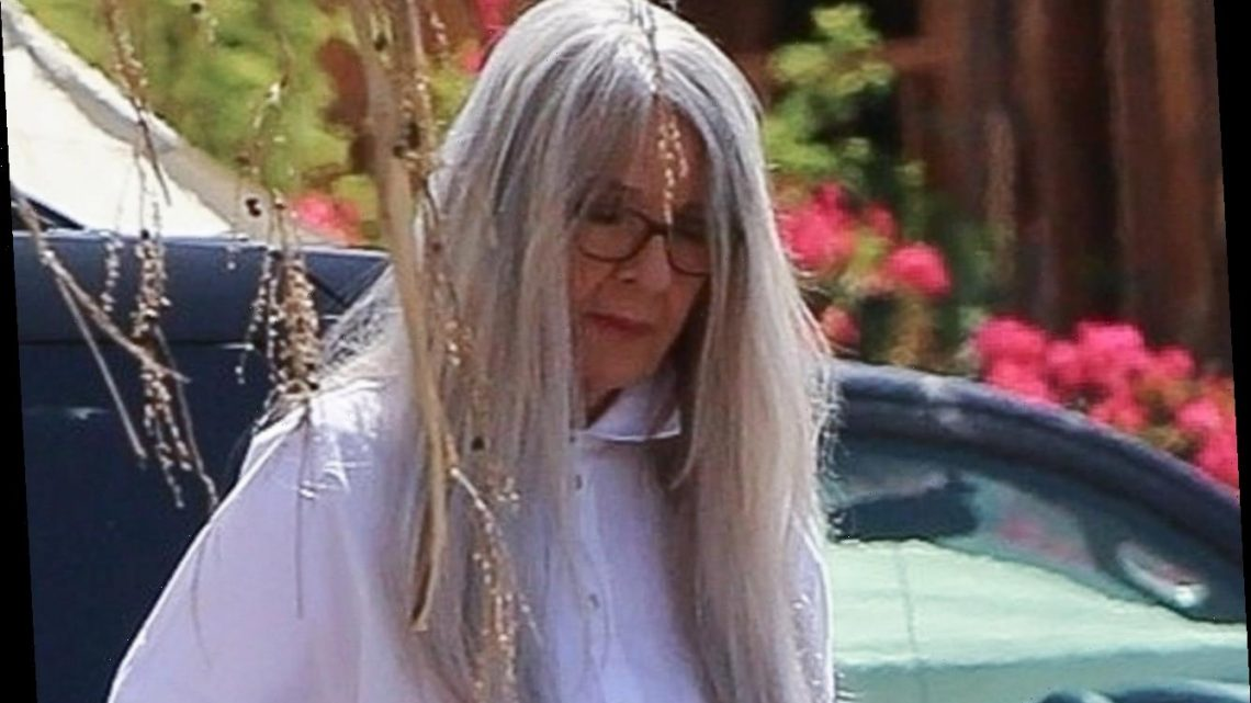 Diane Keaton, 75, is unrecognisable as she wears a long wig and thigh-high snakeskin boots to film Mack & Rita