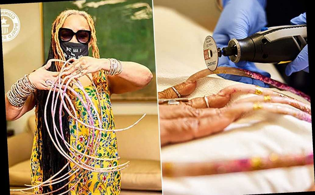 Woman with world's longest nails cuts them off after nearly 30 years