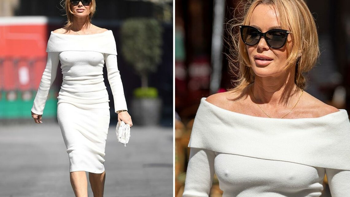 Amanda Holden looks incredible as she leaves work in a white off-the-shoulder dress