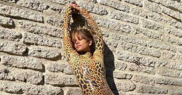 Halle Berry turns up the heat in skintight cheetah bodysuit and thigh-high boots