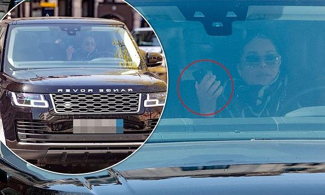 Janet Jackson caught holding her phone while behind the wheel of car