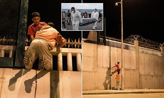 Migrants use ropes to scale Ceuta walls in a bid to sneak into Europe