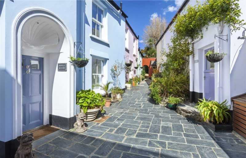 Mysterious front door to 'village within a village' on the market