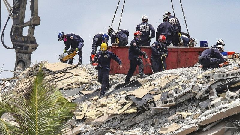 Death toll in Miami building collapse rises as search teams persevere
