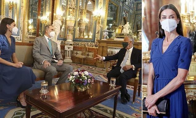 Letizia of Spain stuns in V-neck dress IN Madrid