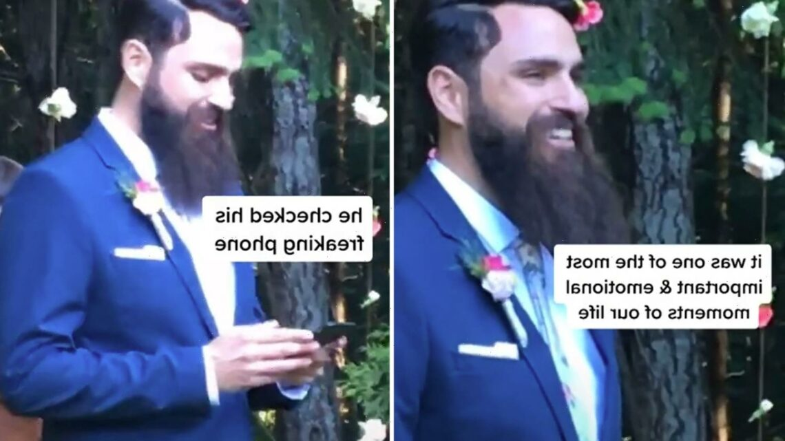 People urge bride to 'walk away' after spotting the awkward moment a groom checks his phone as she walks down the aisle