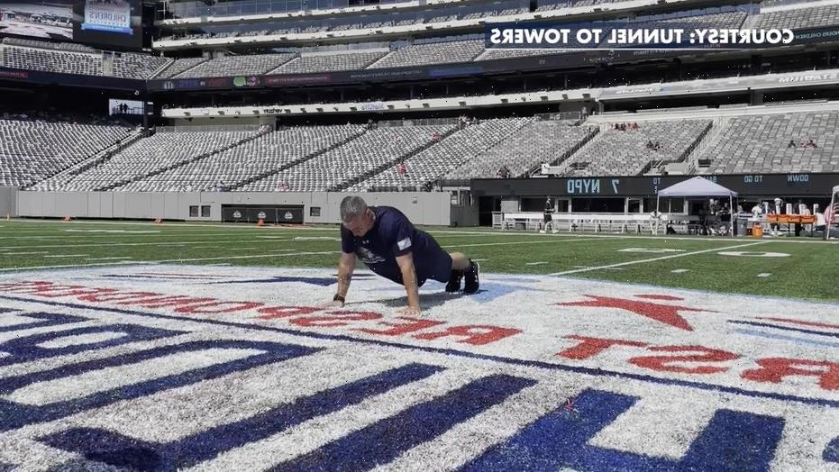 Wisconsin father sets new pushup world record to raise money for family of fallen first responders