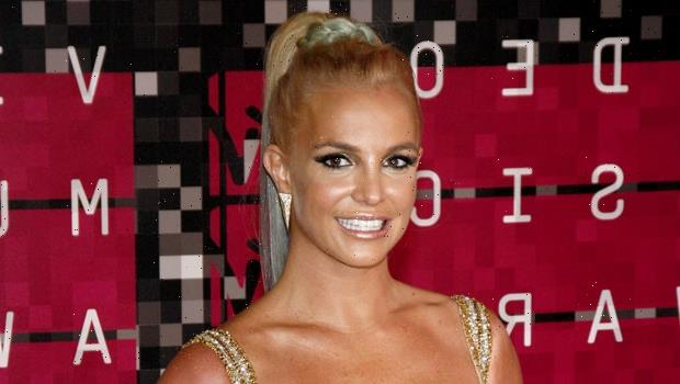 Britney Spears Busts A Move In Hot Pink Catsuit As She Questions If She's A 'Bad Kitty' Or 'Bad Bunny'
