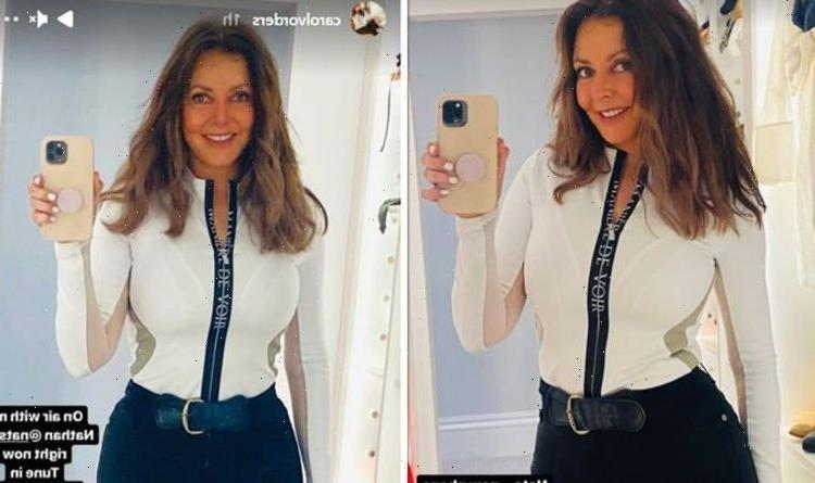 Carol Vorderman, 60, flaunts tiny waist as she calls out fans for moaning at her
