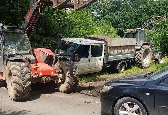 Fly-tippers forced to abandon truck after vigilante farmer and two sons trap dumper with tractors