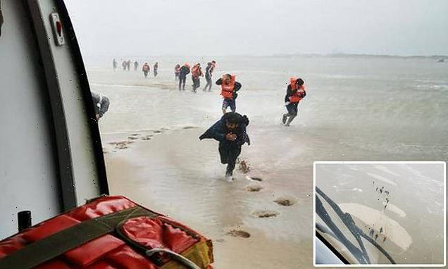 French navy helicopter scrambled as migrants get trapped on coast