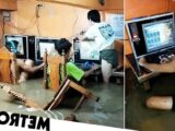 Hardcore gamers carry on playing as room floods during typhoon