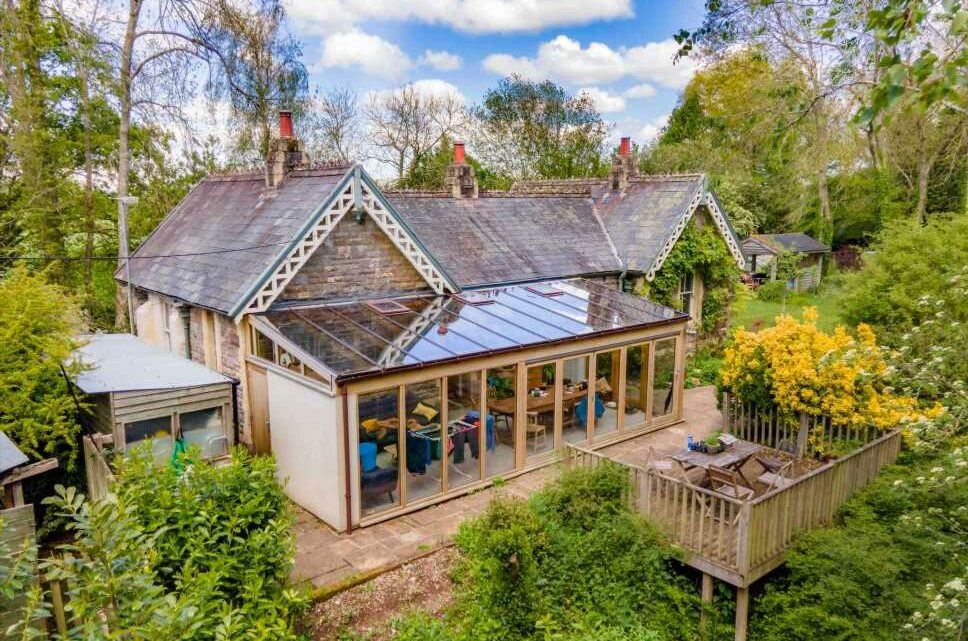 Railway station converted into three-bedroom house with train carriage in garden goes on sale for £550,000