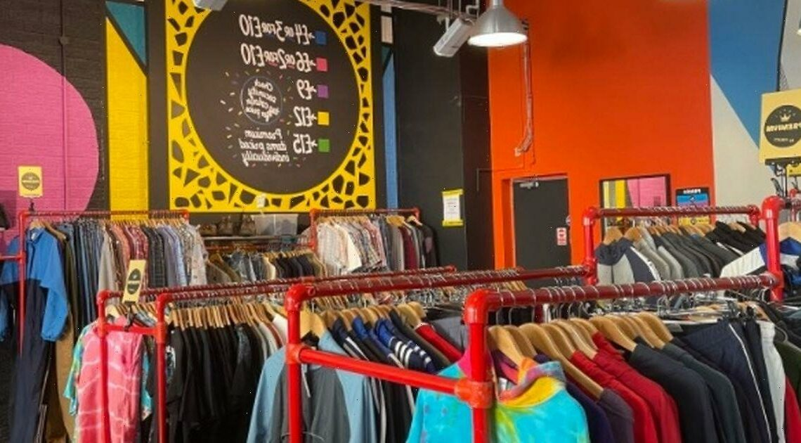 Bargain hunters bag designer clothes and big brands in thrift store lucky dip