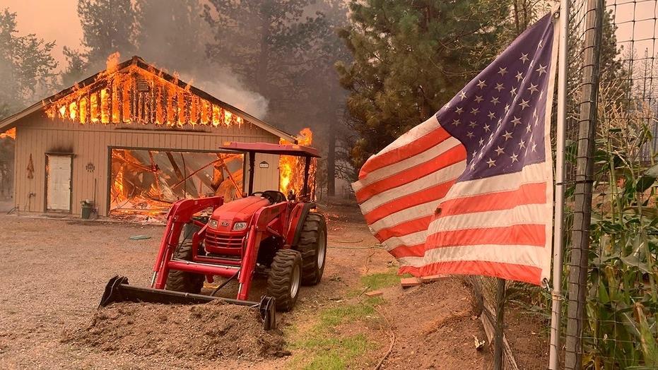 California wildfire threatens homes as blazes burn across West