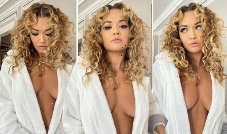 Rita Ora sparks frenzy with daring braless look as she almost spills out of dressing gown