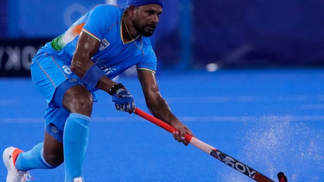 Why are hockey pitches watered at the Tokyo Olympics?