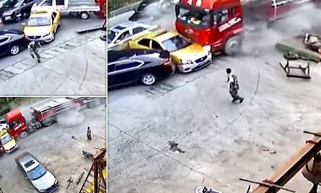 Driver dashes out of the way as lorry ploughs into a line of traffic
