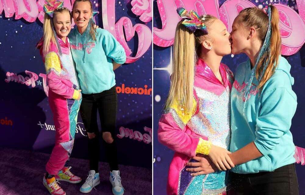 JoJo Siwa kisses girlfriend Kylie Prew during their red carpet debut