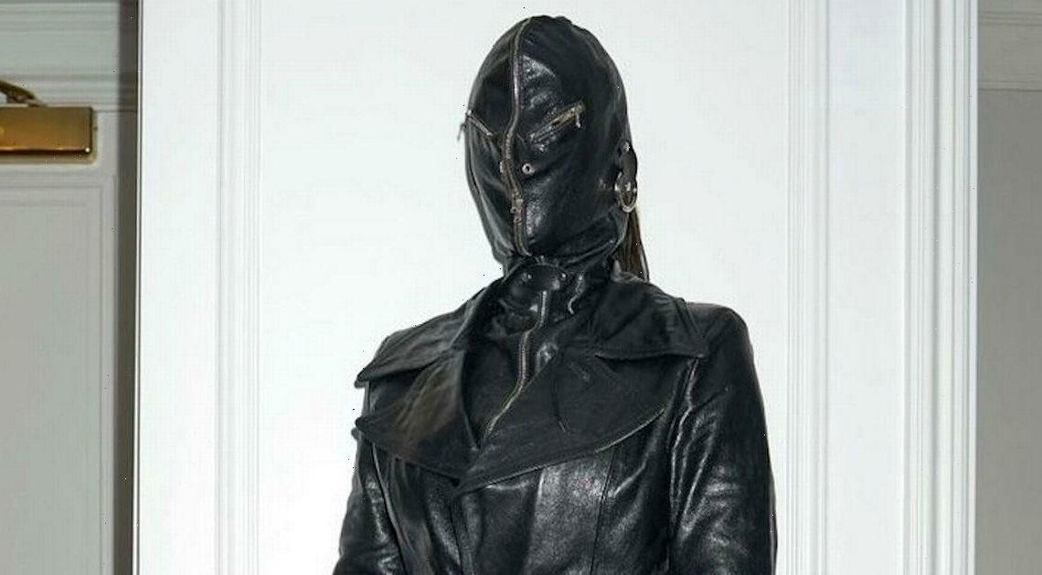 Kim Kardashian slips curves into leather dominatrix ensemble with fetish mask