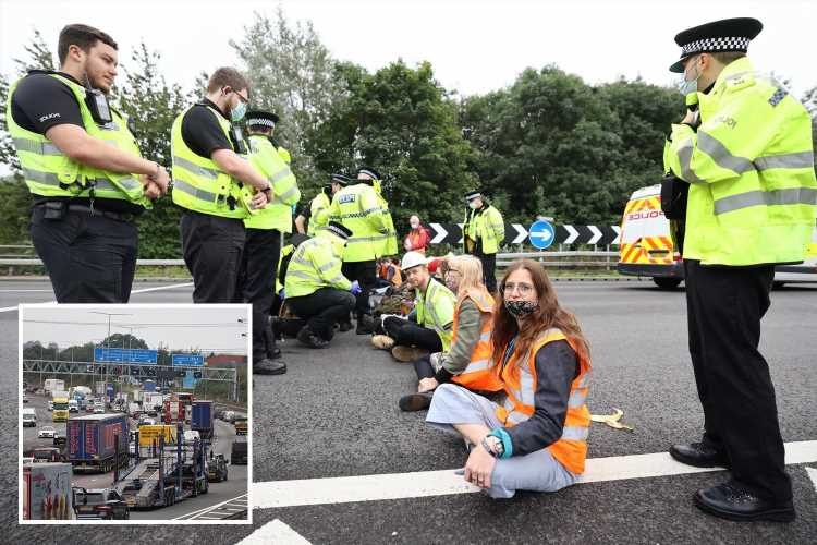 Travel chaos as eco-warriors GLUE THEMSELVES to M25 with cops finally arresting 25 protesters after 2 HOURS